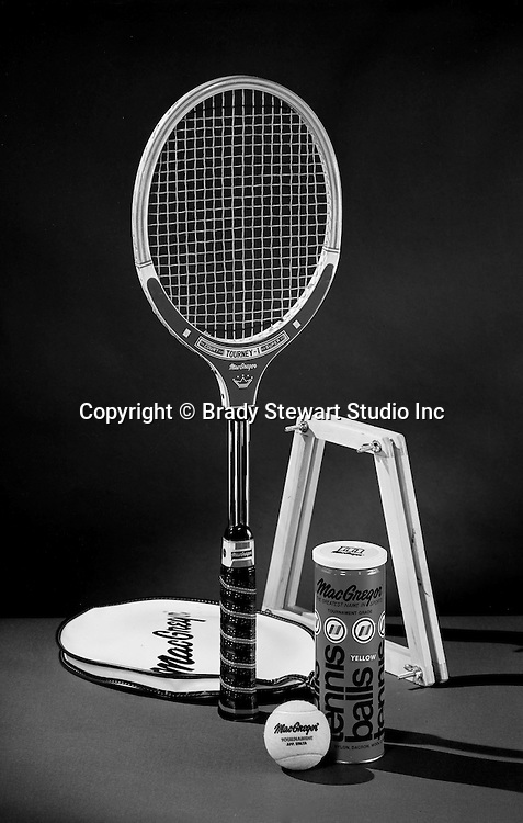 Pittsburgh PA:  MacGregor Tennis Equipment including a wooden tennis racket, tennis balls, cover and three-ball container - 1974.  Studio photography for a local advertising agency and sporting goods store.