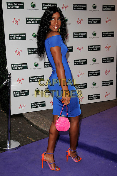 KELLY ROWLAND .The WTA Tour Pre-Wimbledon Party,  Kensington Roof Gardens, London, England..June 18th, 2009.full length blue off the shoulder dress looking over shoulder pink bag purse shoes .CAP/CAS.©Bob Cass/Capital Pictures.