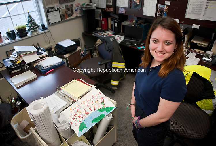 SOUTHBURY, CT-011514JS12-Mary Frances Gannon, a student at University of New Haven, has been working with Southbury Fire Marshal Barry Rickert as an intern in his office. <br /> Jim Shannon Republican-American