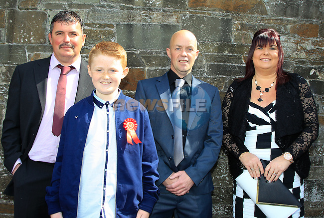 Gerard Shevlin with Mikey, Michael and Audrey Heavey during Confirmation at St. Michael's Clogherhead on Saturday 9th May 2015.<br /> Picture:  Thos Caffrey / www.newsfile.ie