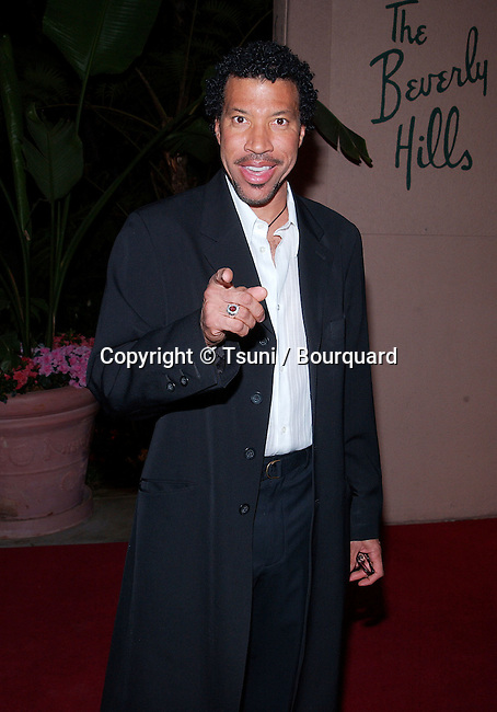 Lionel Richie arriving at the Clive Davis Pre-Grammy party at the Beverly Hills Hotel in Los Angeles. February 26, 2002.           -            RichieLionel02.jpg