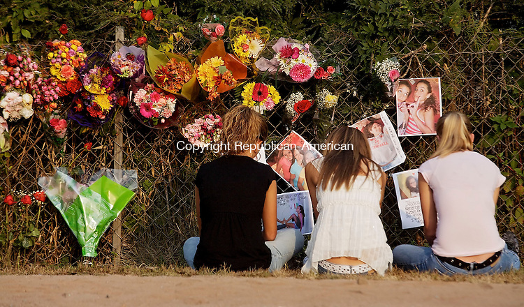 WOLCOTT, CT--05 October 07--100507TJ02 - Unidentified students gather at a makeshift memorial on East Street in Wolcott, by the Farmingbury Hills Golf Course, the site of a crash yesterday that claimed the lives of Anthony Apruzzese, his sister, Jessica, and Jessica's friend Thamara Correa, on Friday, October 5, 2007. T.J. Kirkpatrick/Republican-American