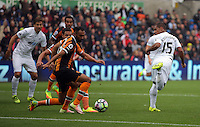 Wayne Routledge of Swansea (R) fails to score with his back heel during the Premier League match between Swansea City and Hull City at the Liberty Stadium, Swansea on Saturday August 20th 2016
