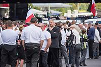 """Ueber 1.000 Rechtsextreme aus mehreren Bundeslaendern demonstrieren am Samstag den 19. August 2017 in Berlin zum Gedenken an den Hitler-Stellvertreter Rudolf Hess.<br /> Rudolf Hess hatte am 17. August 1987 im Alliierten Kriegsverbrechergefaengnis in Berlin Spandau Selbstmord begangen. Seitdem marschieren Rechtsextremisten am Wochenende nach dem Todestag mit sog. """"Hess-Maerschen"""".<br /> Weit ueber 1.000 Menschen protestierten gegen den Aufmarsch der Rechtsextremisten und stoppten den Hess-Marsch nach 300 Metern u.a. mit Sitzblockaden. Der rechtsextreme Aufmarsch wurde daraufhin von der Polizei umgeleitet.<br /> Aus dem Aufmarsch wurden mehrfach Gegendemonstranten angegriffen, mindestens ein Neonazi wurde festgenommen.<br /> Im Bild: mit Trachtenjacke, Stefan Koester, NPD-Bundesgeschaeftsfuehrer und Vorsitzender der NPD in Mecklenburg-Vorpommern.<br /> 19.8.2017, Berlin<br /> Copyright: Christian-Ditsch.de<br /> [Inhaltsveraendernde Manipulation des Fotos nur nach ausdruecklicher Genehmigung des Fotografen. Vereinbarungen ueber Abtretung von Persoenlichkeitsrechten/Model Release der abgebildeten Person/Personen liegen nicht vor. NO MODEL RELEASE! Nur fuer Redaktionelle Zwecke. Don't publish without copyright Christian-Ditsch.de, Veroeffentlichung nur mit Fotografennennung, sowie gegen Honorar, MwSt. und Beleg. Konto: I N G - D i B a, IBAN DE58500105175400192269, BIC INGDDEFFXXX, Kontakt: post@christian-ditsch.de<br /> Bei der Bearbeitung der Dateiinformationen darf die Urheberkennzeichnung in den EXIF- und  IPTC-Daten nicht entfernt werden, diese sind in digitalen Medien nach §95c UrhG rechtlich geschuetzt. Der Urhebervermerk wird gemaess §13 UrhG verlangt.]"""