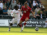 ATTENTION SPORTS PICTURE DESK<br /> Pictured L-R: Jason Scotland of Swansea against Liam Fontaine of Bristol<br /> Re: Coca Cola Championship, Swansea City FC v Bristol City FC at the Liberty Stadium Swansea, south Wales. Saturday 18 April 2009.<br /> Picture by D Legakis Photography / Athena Picture Agency, Swansea 07815441513