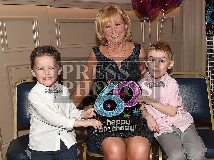 Rosie Smith celebrating her 60th birthday with grandson Cillian and his friend Morgan in the Thatch. Photo:Colin Bell/pressphotos.ie