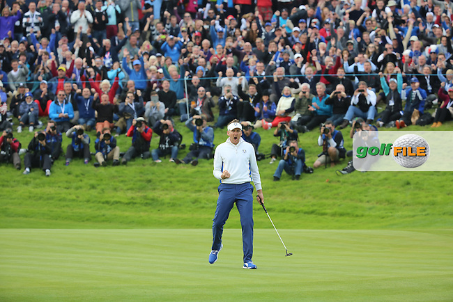 Ian Poulter (EUR) celebrates during the Saturday morning Fourballs of the 2014 Ryder Cup at Gleneagles. The 40th Ryder Cup is being played over the PGA Centenary Course at The Gleneagles Hotel, Perthshire from 26th to 28th September 2014.: Picture Kenneth E.Dennis, www.golffile.ie: \27/09/2014\
