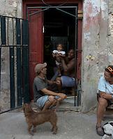 street scene with family, kid and dog  in Havana, Cuba