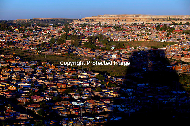 SOWETO, SOUTH AFRICA: An overview of Diepkloof section in Soweto. The township is South Africa's largest township and it was founded about one hundred years to make housing available for black people south west of downtown Johannesburg. The estimated population is between 2-3 million. Many key events during the Apartheid struggle unfolded here, and the most known is the student uprisings in June 1976, where thousands of students took to the streets to protest after being forced to study the Afrikaans language at school. Soweto today is a mix of old housing and newly constructed townhouses. A new hungry black middle-class is growing steadily. Many residents' work in Johannesburg, but the last years many shopping malls have been built, and people are starting to spend their money in Soweto.  (Photo by Per-Anders Pettersson)