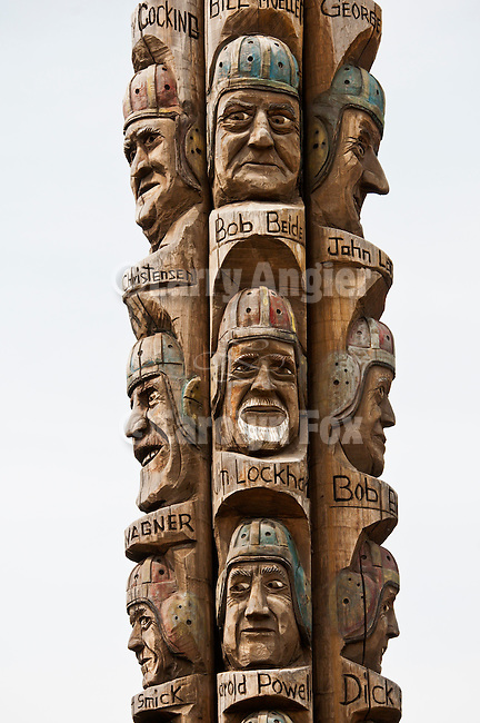 Colfax, Washington's Codger Pole carved by Johnathan LeBenne commemorating the 50th anniversary of a 1938 football game between rival Colfax and St. John High Schools. ..At 65 feet (20 m) tall, it is the largest sculpture of its type in the world, and consists of portraits, carved into five upended red cedar logs, of the 51 players involved. The players are shown in old age but are wearing the football uniforms of the thirties