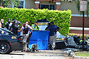 MIRAMAR, FL - MAY 12: Investigators look over the crash site of a Piper PA-34 plane on May 12, 2020 in Miramar, Florida. The plane was seen flying low over an intersection before clipping a power line and crashing, killing the pilot, identified as 25-year-old Mark Daniel Scott, and leaving the flight instructor seriously injured. A third person on the ground was injured by debris.  ( Photo by Johnny Louis / jlnphotography.com )