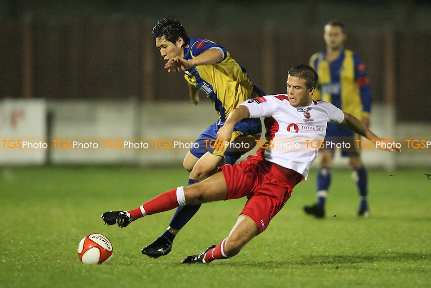 Hyun Jin Lee of Romford is challenged by Lewis Dark of Redbridge - Romford vs Redbridge - Ryman League Division One North Football at Mill Field, Aveley FC - 23/08/11 - MANDATORY CREDIT: Gavin Ellis/TGSPHOTO - Self billing applies where appropriate - 0845 094 6026 - contact@tgsphoto.co.uk - NO UNPAID USE.