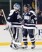 Casey DeSmith (UNH - 29), John Henrion (UNH - 16) - The University of Maine Black Bears defeated the University of New Hampshire Wildcats 5-4 in overtime on Saturday, January 7, 2012, at Fenway Park in Boston, Massachusetts.