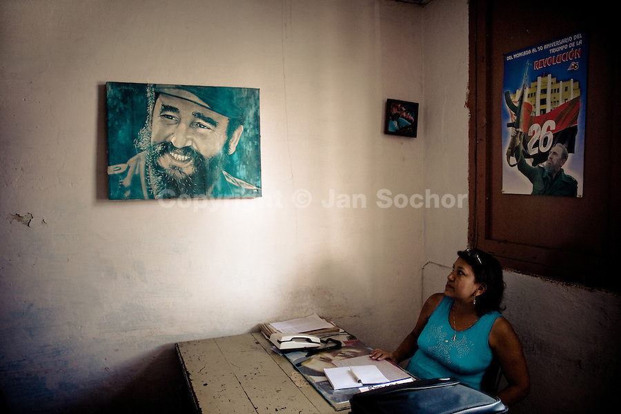 A Cuban woman watches the portrait painting of Fidel Castro, the Cuban Revolution leader, in a state office in Santiago de Cuba, Cuba, 31 July 2008. About 50 years after the national rebellion, led by Fidel Castro, and adopting the communist ideology shortly after the victory, the Caribbean island of Cuba is the only country in Americas having the communist political system. Although the Cuban state-controlled economy has never been developed enough to allow Cubans living in social conditions similar to the US or to Europe, mostly middle-age and older Cubans still support the Castro Brothers' regime and the idea of the Cuban Revolution. Since the 1990s Cuba struggles with chronic economic crisis and mainly young Cubans call for the economic changes.