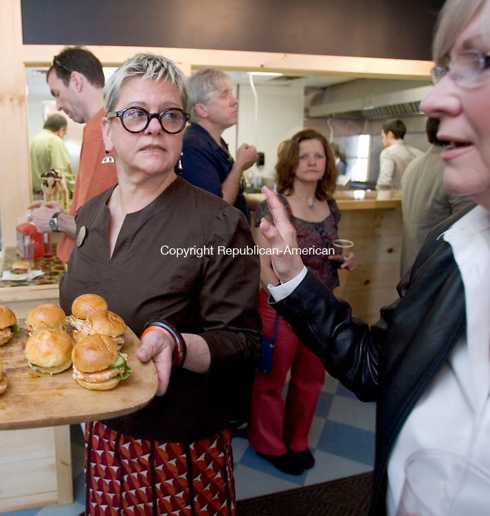 WOODBURY, CT. 26 April 2011-042611SV07--At left, Chef Carole Peck passes out samples of her burgers at her new restaurant, Zee Burger, in Woodbury Tuesday. Peck was having a soft opening, passing out free burgers to friends and town officials before the restaurant officially opens Monday.<br /> Steven Valenti Republican-American