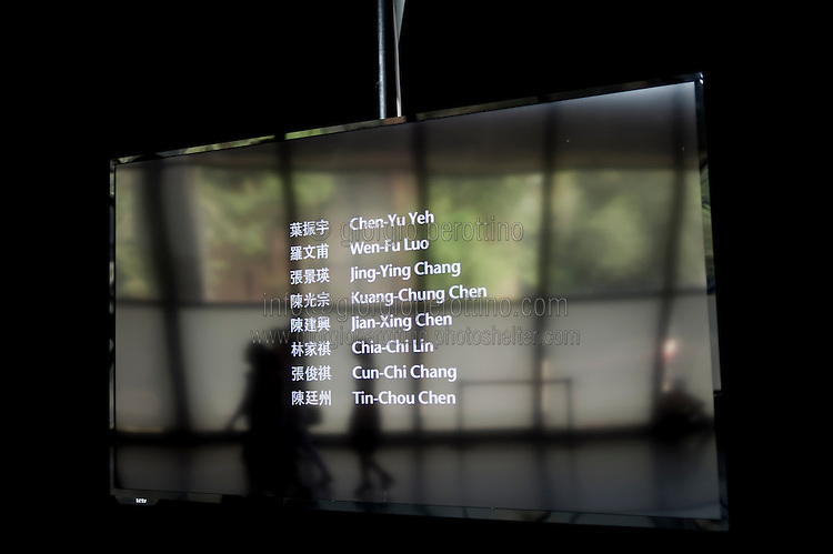 """People visit the """"We love video this summer"""" exhibition at Pace Beijing Art Gllery at 798 Art District in Beijing, China, August 19, 2014. <br /> <br /> 798 Art District (Chinese: 798艺术区; pinyin: 798 Yìshùqū), or Dashanzi Art District, is a 50-year old decommissioned military factory buildings with unique architectural style. Located in Chaoyang District of Beijing, that houses a thriving artistic community. Since the beginning of 2000, 798 has become a centre for art galleries, artists's ateliers and contemporary arts exhibitions. The buildings are within alleys number 2 and 4 on Jiǔxiānqiáo Lù (酒仙桥路), south of the Dàshānziqiáo flyover (大山子桥). <br /> <br /> © Giorgio Perottino"""
