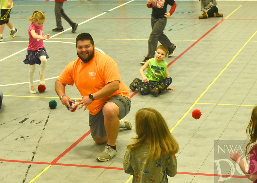 NWA Democrat-Gazette/FLIP PUTTHOFF <br /> EYE ON THE SPRING BREAK BALL<br /> Juan Jacobo, with the Rogers Activity Center staff, winds up to throw Wednesday March 20 2019 during a game of spider ball at the center. The game is like dodge ball only no one is out when they're hit, Jacobo said, and lots of balls are used. The game was part of spring break activities at the center, 315 W. Olive St. Bowling at Rogers Bowling Center is the center's main spring break event today.