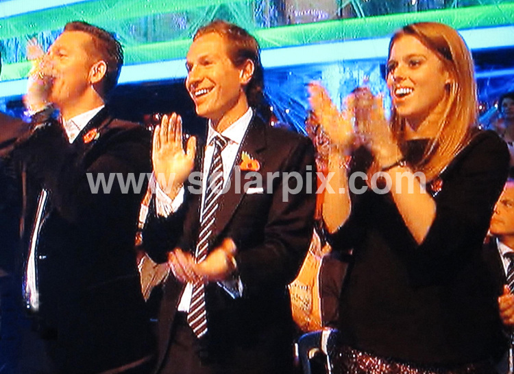 **ALL ROUND PICTURES FROM SOLARPIX.COM**                                             **NO UK NEWSPAPER PUBLICATION**.**UK MAGAZINE & SUPPLEMENT PUBLICATION ONLY** AND NO PUBLICATION IN AUSTRALIA, BELGIUM, FRANCE, GERMANY, ITALY, SCANDINAVIA AND USA**                                                                                  Caption: Princess Beatrice and her boyfriend Dave Clark pictured in the audience of  Strictly Come Dancing  realty TV show.                                                                              This pic:  Princess Beatrice & Dave Clark                                                                                            JOB REF:14127        SFE       DATE: 29.10.2011                                                           **MUST CREDIT SOLARPIX.COM OR DOUBLE FEE WILL BE CHARGED**                                                                      **MUST AGREE FEE BEFORE ONLINE USAGE**                               **CALL US ON: +34 952 811 768 or LOW RATE FROM UK 0844 617 7637**