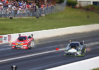 May 22, 2016; Topeka, KS, USA; NHRA funny car driver Alexis DeJoria (right) races alongside Chad Head during the Kansas Nationals at Heartland Park Topeka. Mandatory Credit: Mark J. Rebilas-USA TODAY Sports