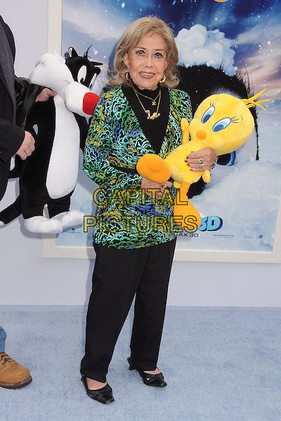 June Foray.The World Premiere of 'Happy Feet Two' held at The Grauman's Chinese Theatre in Hollywood, California, USA..November 13th, 2011.full length green blue yellow print top stuffed toy tweety bird black trousers .CAP/ADM/BP.©Byron Purvis/AdMedia/Capital Pictures.