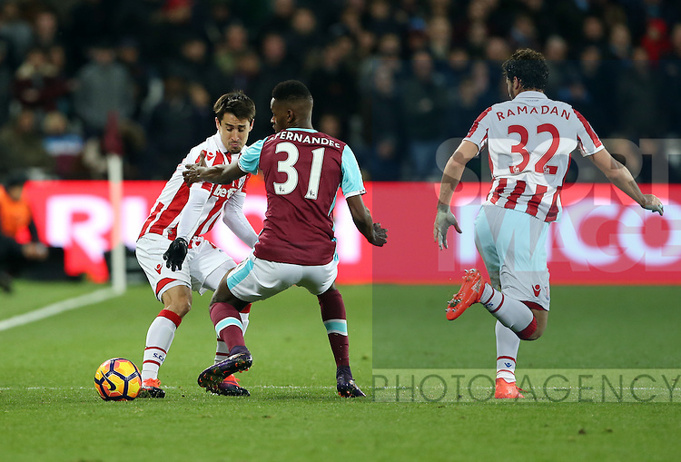 West Ham's Edmilson Fernandes tussles with Stoke's Bojan Krkic during the Premier League match at the London Stadium, London. Picture date November 5th, 2016 Pic David Klein/Sportimage
