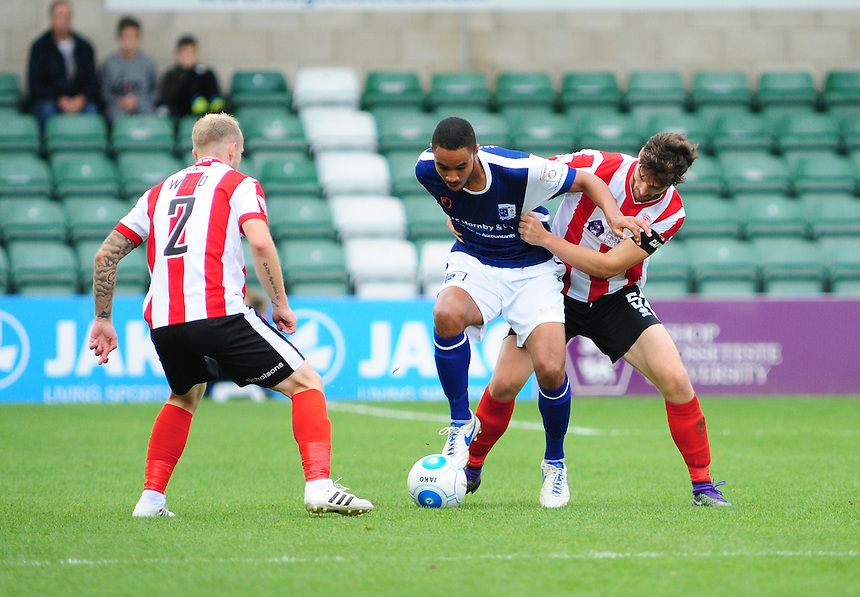 Lincoln City's Luke Waterfall vies for possession with Barrow's Byron Harrison<br /> <br /> Photographer Andrew Vaughan/CameraSport<br /> <br /> Vanarama National League - Lincoln City v Barrow - Saturday 17 September 2016 - Sincil Bank - Lincoln<br /> <br /> World Copyright &copy; 2016 CameraSport. All rights reserved. 43 Linden Ave. Countesthorpe. Leicester. England. LE8 5PG - Tel: +44 (0) 116 277 4147 - admin@camerasport.com - www.camerasport.com
