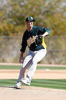 Grant Balfour #50 of the Oakland Athletics pitches a live batting practice session in spring training workouts at the Athletics complex on February 23, 2011  in Phoenix, Arizona. .Photo by:  Bill Mitchell/Four Seam Images.