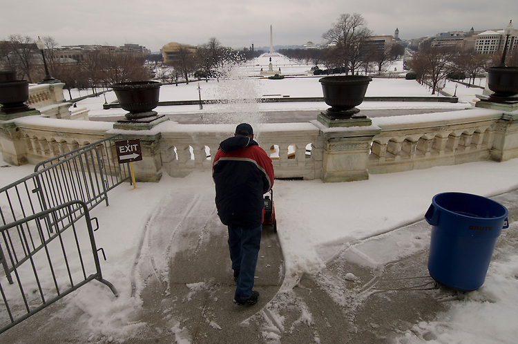 AOC workers clean the West Front Terrace of the U.S. Capitol after an overnight ice storm left most of the Washington area with school closures and a delay in the opening of the federal government.