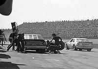Rick Wilson 4 Buddy Baker 88 pits pit stop Daytona 500 at Daytona International Speedway in Daytona Beach, FL in February 1986. (Photo by Brian Cleary/www.bcpix.com) Daytona 500, Daytona International Speedway, Daytona Beach, FL, February 16, 1986.  (Photo by Brian Cleary/www.bcpix.com)