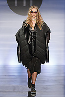 Model walks runway in an outfit by Eleni Kouvaris, during the Future of Fashion 2017 runway show at the Fashion Institute of Technology on May 8, 2017.