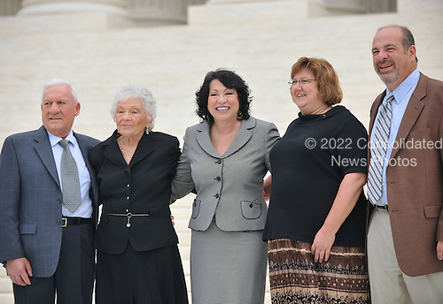 Washington, DC - September 8, 2009 -- Associate Supreme Court Justice Sonia Sotomayor  and her family smile for photographers following the investiture ceremony in her honor at the United States Supreme Court in Washington, D.C. on Tuesday, September 8, 2009.  From left to right: Mr. Omar Lopez, Stepfather; Mrs. Celina Sotomayor, Mother; Mrs. Tracey Sotomayor, Sister-in-law; and Dr. Juan Sotomayor, Brother..Credit: Ron Sachs / CNP