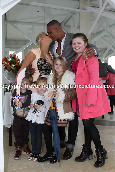 EXCLUSIVE PICTURE: TREVOR ADAMS / MATRIXPICTURES.CO.UK.PLEASE CREDIT ALL USES.  .WORLD RIGHTS..***EXCLUSIVE FEES TO BE AGREED BEFORE USE***..British media personality Kerry Katona and her boyfriend of eight months, ex rugby league ace George Kay, are pictured just after George proposed with a diamond ring on top of the Blackpool Tower in Lancashire. ..The couple look ecstatic as they celebrate the joyous occasion with Kerry's children Heidi, Max, Lilly and Molly...After coming down from the tower, they had a family meal together before Kerry was seen, still very much in high spirits, showing off her engagement ring and taking a bottle of champagne back to her hotel room. She even posed for a picture with a hen party as the night drew to a close...***EXCLUSIVE FEES TO BE AGREED BEFORE USE***..APRIL 13th 2013..REF: BMP 132431