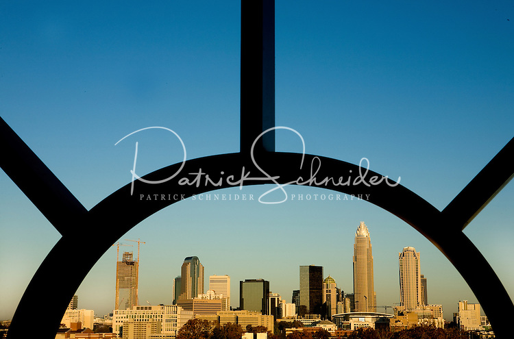 The uptown Charlotte is framed between architectural detailing at sunrise in Charlotte, N.C.
