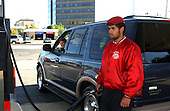 """Alexandria, VA - October 14, 2002 -- The Guardian Angels pump gas at Belle Haven Texaco in Alexandria, VA.  Ramon Quiles, codename """"Knockout"""" pumps gas for Shannon Sheahan of Bristow, VA.<br /> Credit: Ron Sachs / CNP<br /> (RESTRICTION: NO New York or New Jersey Newspapers or newspapers within a 75 mile radius of New York City)"""