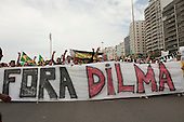 Protesters carry a banner with 'FORA DILMA' (Dilma Out). Rio de Janeiro, Brazil, 15th March 2015. Popular demonstration against the President, Dilma Rousseff in Copacabana. Photo © Sue Cunningham sue@scphotographic.com.