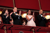 United States President Barack Obama and First Lady Michelle Obama attend the program recognizing the 37th Kennedy Center Honorees at the John F. Kennedy Center for the Performing Arts in Washington, D.C. on Sunday, December 7, 2014. From left to right:  Lily Tomlin, Tom Hanks, the first lady and the President.  <br /> Credit: Dennis Brack / Pool via CNP