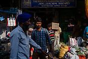 People walk along a street in the market stall in Kolkata, India, on Saturday, May 27, 2017. Photographer: Sanjit Das