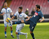 Gonzalo Higuain and  Lorenzo Tonelli    in action during the Italian Serie A soccer match between   SSC Napoli and Empolii    at San Paolo   stadium in Naples , December 07, 2014
