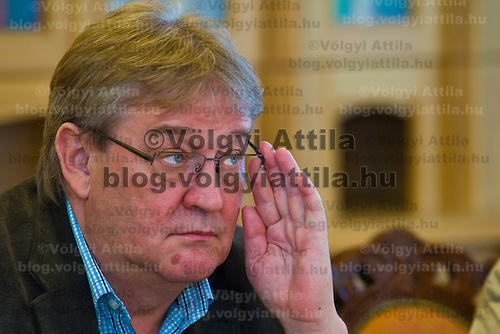 Istvan Gasko leader of VDSZSZ railway labor union adjusts his glasses during a press conference.