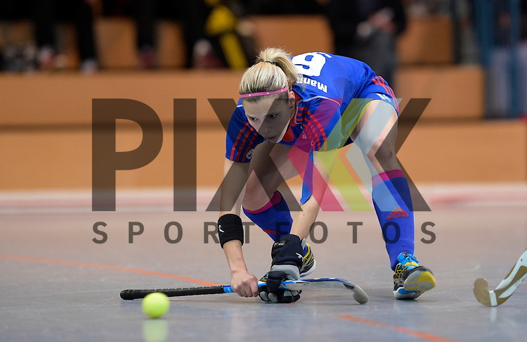 GER - Mannheim, Germany, December 19: During the 1. Bundesliga Sued Damen indoor hockey match between Mannheimer HC (blue) and Nuernberger HTC (red) on December 19, 2015 at Irma-Roechling-Halle in Mannheim, Germany.  Vera Battenberg #64 of Mannheimer HC<br /> <br /> Foto &copy; PIX-Sportfotos *** Foto ist honorarpflichtig! *** Auf Anfrage in hoeherer Qualitaet/Aufloesung. Belegexemplar erbeten. Veroeffentlichung ausschliesslich fuer journalistisch-publizistische Zwecke. For editorial use only.