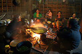 INDONESIA, Flores, women sit in the kitchen and prepare a meal for the community of Wae Rebo Village
