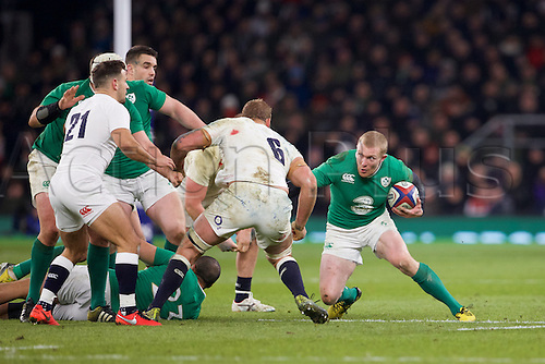 27.02.2016. Twickenham, London, England. RBS Six Nations Championships. England versus Ireland. Ireland wing Keith Earls attempts to get past England flanker Chris Robshaw.