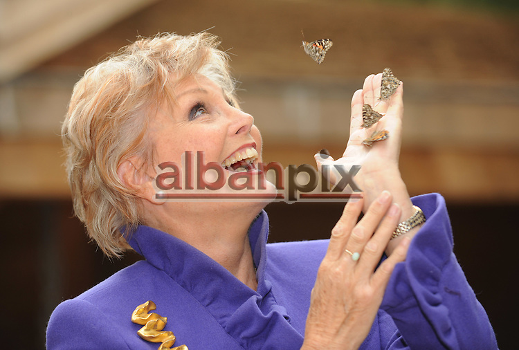 Veteran newsreader, presenter and author Angela Rippon releases butterfly's to mark the opening of the new £3.2m 72-acre Chiltern Woodland Burial Park.