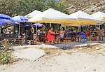 People at outdoor Rew Rew restaurant cafe tables Mgarr ix-Xini, island of Gozo, Malta