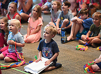 NWA Democrat-Gazette/J.T. WAMPLER Sage Clark, 3, sits front and center as Bobby Matthews and Virginia Ralph perform as mšmandpšp Tuesday July 3, 2018 at the Fayetteville Public Library. The show was geared towards preschool aged children. For information about events at the library visit www.faylib.org. Sage was at the Library with his mom, Jessica Clark of Fayetteville.