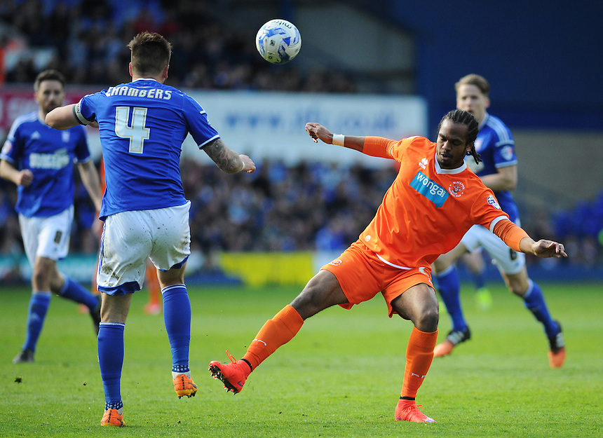 Blackpool's Nathan Delfouneso vies for possession with Ipswich Town's Luke Chambers<br /> <br /> Photographer Kevin Barnes/CameraSport<br /> <br /> Football - The Football League Sky Bet Championship - Ipswich Town v  Blackpool - Saturday 11th April 2015 - Portman Road - Ipswich<br /> <br /> &copy; CameraSport - 43 Linden Ave. Countesthorpe. Leicester. England. LE8 5PG - Tel: +44 (0) 116 277 4147 - admin@camerasport.com - www.camerasport.com