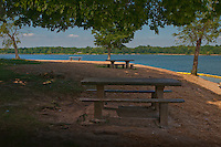 Three concrete picnic tables and three trees in the park at Red Bank Landing on Hoover Reservoir in Westerville, Ohio.