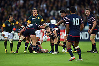 Niku Kruger of the USA passes the ball back to team-mate Shalom Suniula of the USA. Rugby World Cup Pool B match between South Africa and the USA on October 7, 2015 at The Stadium, Queen Elizabeth Olympic Park in London, England. Photo by: Patrick Khachfe / Onside Images