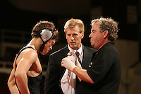27 February 2006: Stanford's Tanner Gardner vs. Cal Poly's Chad Mendes during the 125 lbs. Pac-10 Wrestling Championships at Maples Pavilion in Stanford, CA. Pictured also are Kevin Klemm and trainer Perry Archibald.