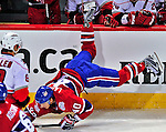 21 December 2008: Montreal Canadiens' center Maxim Lapierre takes a tumble in the first period against the Carolina Hurricanes at the Bell Centre in Montreal, Quebec, Canada. The Hurricanes defeated the Canadiens 3-2 in overtime. ***** Editorial Sales Only ***** Mandatory Photo Credit: Ed Wolfstein Photo